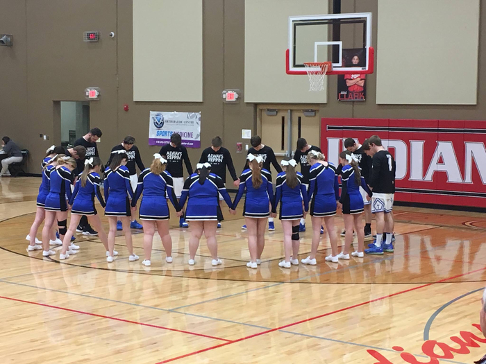 Proud of our basketball team and cheerleaders for praying for Chris Raubach before the game!